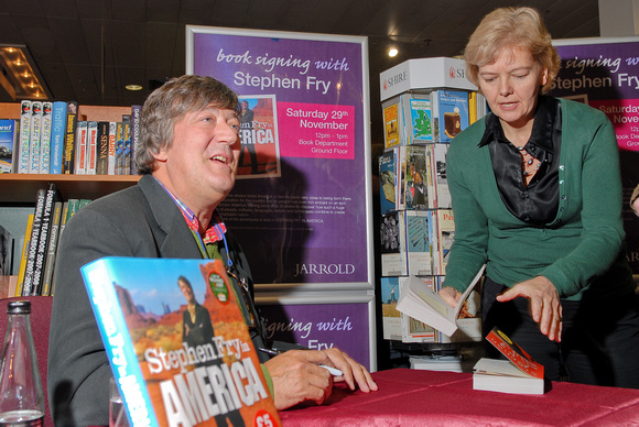 Stephen Fry signing his books